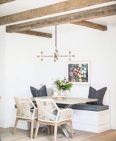 relaxing dining area, checkeboard pillows, fruits photography, wooden beams