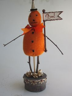 I don't know what it is about this pumpkin guy that I like.  Maybe it's the hat.  Maybe it's the knitted look.  Maybe it's the use of twigs.  I just like it.  $18.99