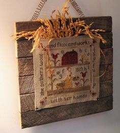 Wood hanging sampler By Ruthe Martz. A Primitive Needleworks By Caryn