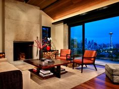contemporary living room by Garret Cord Werner Mediterranean Living Rooms, Modern Mediterranean Homes, Concrete Fireplace, Fireplace Design, Stain Concrete, Simple Fireplace, Concrete Walls, Fireplace Mantel, Concrete Countertops