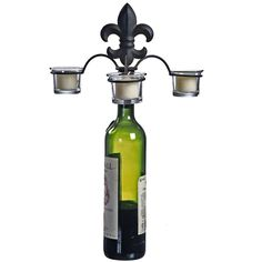 Illuminate your time with friends and family at home with our oldworld french inspired wine bottle candelabra centerpiece. Featuring three tea light candle holders and an elastic cork base to safe-...