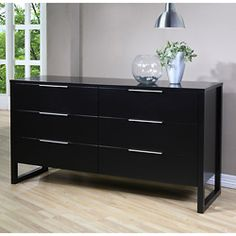 It's meant for the bedroom but I'm using this dresser in my living room as a chic TV stand with plenty of hidden* storage.