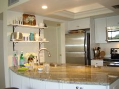 The well-designed kitchen is compact but features plenty of work space and a breakfast bar.  Open to the great room, the cook is never cut off from fellow vacationers and can enjoy the beautiful tropical views of  palm trees, flowers  and sunny blue skies outside.