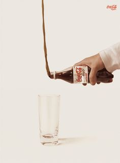 "This advertisement is not something you see every day, making it very appealing to the eye. The Coca-Cola ""defying gravity"" is a clever way to promote the ""light"" feature of the drink."