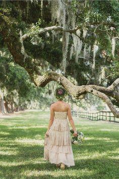 Dress Designer:BHLDN  Hair and Makeup Artist:Stella Nova  Floral Designer:Wildflowers, Inc.