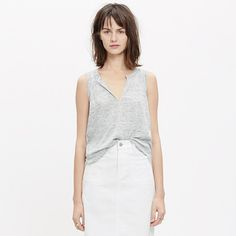A skin-baring split neckline gives this tank top a sexy feel. We're obsessed with our airy linen that keeps its shape while still having a cool drape.   <ul><li>True to size.</li><li>Linen.</li><li>Hand wash.</li><li>Import.</li></ul>