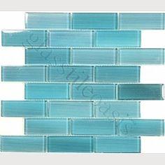 Love the color/look- (though NO tile behind stove top) glass tile backsplash