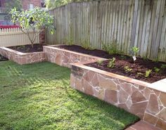 Image from http://www.landscapebyak.com.au/images/retaining%20wall%20garden%20bed.JPG.