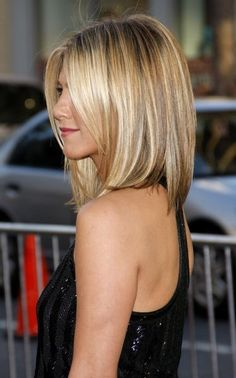 Jennifer Aniston long bob; no layers & slightly angled in the front...clean and simple