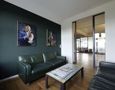 Contemporary Office Interior Design Meeting Space With Natural Wood  Flooring And Dark Green