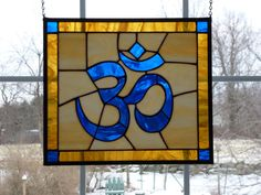 Stained glass Om symbol panel by WildheartGlassDesign on Etsy