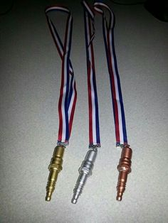 Spark plug medals for Pinewood Derby.
