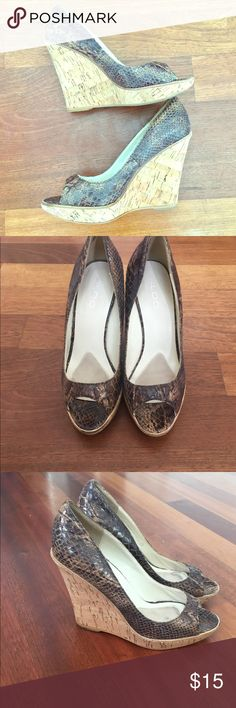 Faux snakeskin Aldo peep toe wedges. Size 37(US 7) EUC. Faux snakeskin with cork wedges. Some wear on the bottom (see pics) but overall gorgeous! 30% off bundles of 2 or more items from my closet. Aldo Shoes Wedges