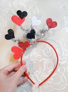 A festive Valentines headband suitable for the queen of hearts! A spray of hearts appears to float above the wearers head. So cute for a party, or