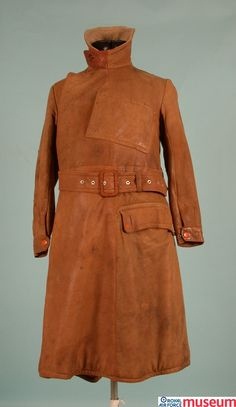 RFC leather flying coat.    This is an RFC leather flying coat. Flying exposed pilots to the elements, commonly causing wind burn. They adopted leather wear inspired by clothing worn by drivers of open air motor vehicles of the time. The skirt of this coat is fitted with leather straps with press studs for securing to the wearer's legs in the event of bad weather.