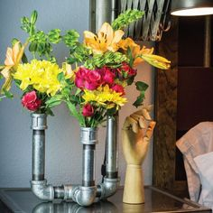 Add some industrial chic flair to your floral arrangements with this DIY vase made from pipe and fitting from the hardware store.