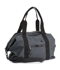 Soft nylon gym bag with double handles, zip at top, and a detachable, adjustable shoulder strap. One outer compartment with zip, one inner compartment with zip, and two larger inner compartments in mesh. | H&M Sport