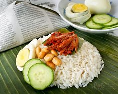 The ever popular and delicious Nasi Lemak Bungkus served with spicy anchovies…