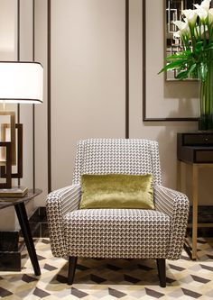 patterned black and white on a mid-century modern chair. chartreuse velvet accent pillow