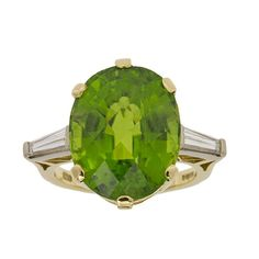 Peridot Diamond Gold Ring   From a unique collection of vintage cocktail rings at https://www.1stdibs.com/jewelry/rings/cocktail-rings/