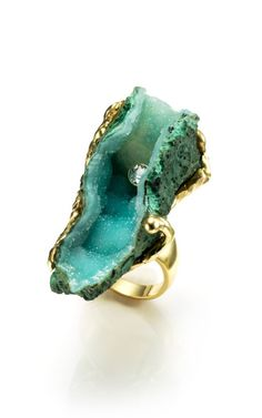This stunning 18K alternative engagement ring by Kara Ross features a cavernous raw African green dioptase stone with a singular brilliant cut diamond18K gold with raw African green dioptase and .42 carat white diamond. Dioptase, an intense emerald-green to bluish-green copper cyclosilicate mineral, has a hardness of 5, the same as tooth enamel.