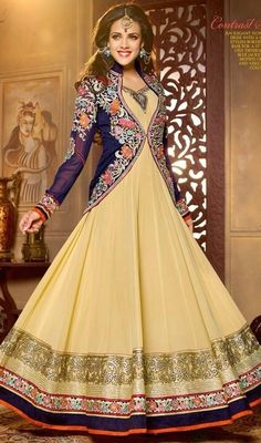 Captivate the masses in your graceful looks draped on this beige embroidered georgette flared Anarkali suit. The butta, lace and resham work looks chic and great for any get together. #GorgeousDarkVioletEmbroideredFlaredAnarkali