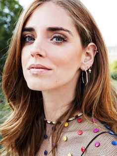 Chiara Ferragni pairs an embellished dress with dainty earrings