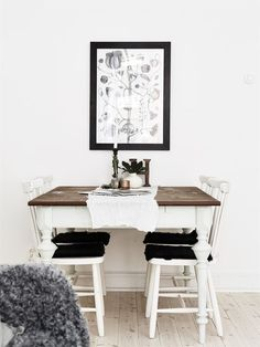 Rustic and scandinavian wooden table with chairs.