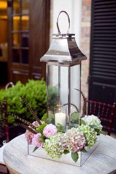Beautiful centerpiece...I love lanterns and hydrangea.
