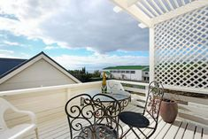 This Simonstown holiday cottage sleeps 6 - 4 adults and two kids in a 2 bedroom.   The cottage has beautiful sea views from the lounge, bedroom, front deck and outside patio, with the mountain as a backdrop. The cottage has two bedrooms (one double and one with 2 single beds) an inside bathroom plus a second bathroom with shower, with access from the garden, a beautiful and spacious open plan kitchen/dining and lounge area leading out onto a sun deck with sea views. Cape Town Holidays, Boulder Beach, Open Plan Kitchen Dining, Single Beds, Self Catering Cottages, Outside Patio, Front Deck, Luxury Accommodation, Al Fresco Dining