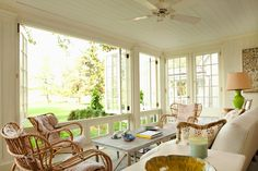Leta Austin Foster: Enclosed patio with beadboard ceiling and ceiling fan. Folding glass windows and wood ...