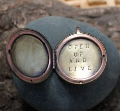 A reminder to open your heart to really living today. Yes. :: a whispered soul mantra locket