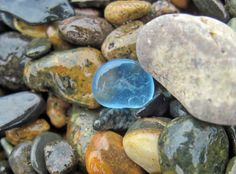 Pale blue beach glass among the rocks and pebbles - yes! See more...