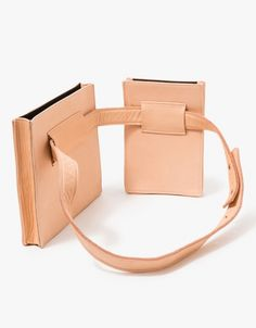 From Collina Strada, a leather fanny pack in Blush with minimalist styling.  Features adjustable belt, side pouch, main pouch, fully lined and rectangular silhouettes.  •	Soft leather fanny pack in Blush  •	Adjustable belt •	Side pouch •	Main pouch w