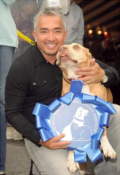 "We had to have the ""Dog Whisperer"" in this gallery.  Canine behavior expert Cesar Millan is a dad to many rehabilitated dogs.  He's here with his pup Daddy at the 2009 Pet Adoptathon at North Shore Animal League America."
