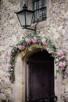 Image by - Lola Rose Photography - Pink Church Flower Arch - Sottero & Midgely Lace Wedding Dress and Rachel Simpson Shoes for a rustic country wedding in a barn with delicate pastel flowers. Bridesmaids in Navy & Groom in Grey Bartlett and Butcher Suit.