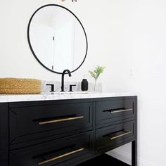 Does hardware really matter? I would say most definitely yes! As you can see with this black Robertson vanity from the long brass pulls really make a statement. I think we chose the perfect vanity for our son's bathroom. Bathroom Floor Tiles, Bathroom Faucets, Master Bathroom, Mirror Bathroom, Bathroom Inspo, White Bathroom, Bathroom Lighting, Bathroom Ideas, Bathrooms
