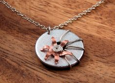 Mixed Metal Pendant Necklace Hardware Washer Copper Flower. $28.00, via Etsy.