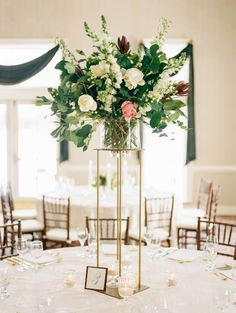 Glamorous tall floral centerpiece: http://www.stylemepretty.com/north-carolina-weddings/mount-airy-north-carolina/2016/03/17/classic-winter-wedding-during-a-major-snowstorm/ | Photography: Marcie Meredith - http://marciemeredith.com/