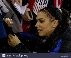 Download this stock image: Washington, USA. 7th Mar, 2017. United States Women's National Team Forward #13 Alex Morgan signs jerseys after a soccer match as part of the SheBelieve Cup 2017 between the United States and France at RFK Stadium in Washington DC. France defeats the United States, 3-0, to win the SheBelieve Cup. Credit: Cal Sport Media/Alamy Live News - HT7R13 from Alamy's library of millions of high resolution stock photos, illustrations and vectors.