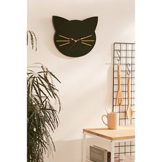 Cat Clock ($29) ❤ liked on Polyvore featuring home, home decor, clocks, urban outfitters clock, urban outfitters, kitty clock, cat clock and cat home decor