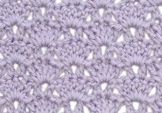 How to crochet: shell and v-stitch. This pretty crochet pattern gives a fairly firm fabric but still lets the light through.
