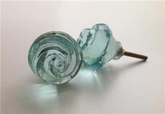 "Pretty soft aqua or clear molded glass cabinet knobs. 1.5"" diameter. Perfectly lovely as dresser drawers knobs / pulls. Freshens any decor."