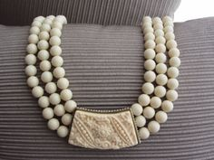 NEW-SOLD-OUT-Heidi-Daus-Carved-Center-Station-Three-Strand-Creamy-Bead-Necklace