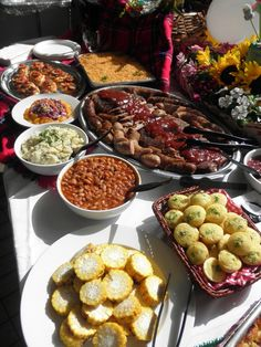 We r having BBQ Pork, Baked Beans, Cornbread Muffins, Coleslaw, Cabbage Slaw and Chips