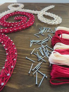 Colorful collection of Red and Cream Embroidery Floss from our Cursive Love String Art Sign!