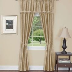 "Tan.  Blackout Curtains. Five Piece ""Window In A Bag"" Set. 100% Blackout embossed leaf design panels with attached straight mushroom fringe valance & two rope tassel tiebacks. Requires just one standard or decorative rod. Set Includes: 2 Blackout Panels Attached Fringe Valance 2 Rope Tassel Tiebacks"