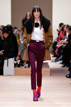 Plum trousers with tailored white blouse and fur-lined parka on the Carven F/W 2015 runway at PFW