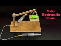 Hydraulic Crain is a simple science project for school students who are interested in science experiments which can be done at home are classroom or any were. Physics Projects, School Science Projects, Stem Projects, Stem Activities, Activities For Kids, Science Classroom, Entertainment System, Science Experiments, Recycling