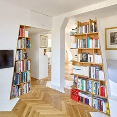 h2o Architectes adds angular shelving units to a book collector's Parisian loft apartment